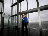 James Episcopou and Laura Taylor kiss after he proposed to her at The View from The Shard