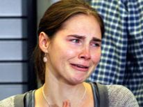 Amanda Knox cries during a news conference in Seattle