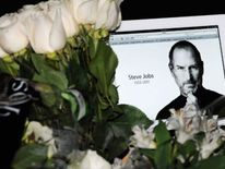 An iPad is left among tributes