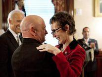 Gabrielle Giffords hugs husband Mark Kelly
