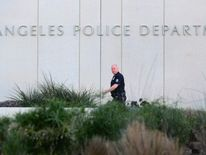 File photo of LAPD officer outside police headquarters in February 2013.