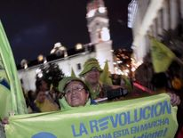 Supporters of Ecuadorean President Rafael Correa celebrate his re-election