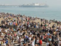 People enjoy the settled and sunny weather on Brighton seafront
