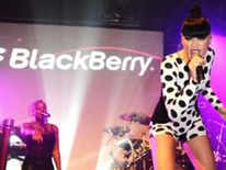 Jessie J performs at the BlackBerry BBM event in London, where a man was stabbed in the neck.