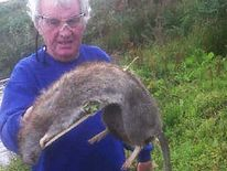 Brian Watson with a giant rat