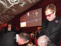 David Furnish and Sir Elton John encourage their son Zachary to meet guests at their annual Elton John Aids Foundation Academy Awards Viewing Party