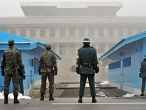 South Korean soldiers stand guard at demilitarised zone.