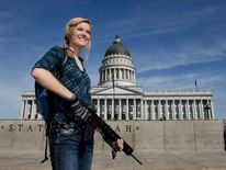 Darci Lund carries an AR-15 at a gun rights rally and march at the Utah State Capitol