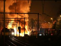 Fire from chemical carriages after the train derailed