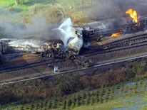 Wreckage from the burnt out chemical carriages after the derailment and fire