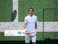 Andy Murray of Great Britain reacts to a decision from Hawk-Eye during the Gentlemen's Singles fourth round match against Mikhail Youzhny of Russia.