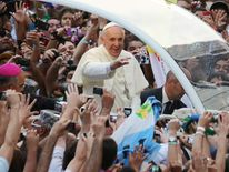 Pope Francis attends a welcome ceremony in Rio De Janeiro