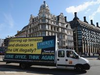 Van displaying Liberty poster against Home Office immigration campaign