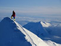 A climber on the summit of Mount McKinley