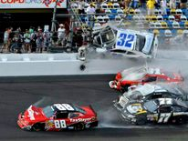 NASCAR driver Kyle Larson and his Chevrolet end up in the fence during the final lap crash during the NASCAR Nationwide Series DRIVE4COPD 300 race at the Daytona International Speedway in Daytona Beach
