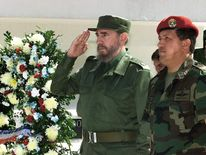 The Cuban President Fidel Castro (L) and