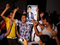 People hold poster of Palestinian singer Assaf