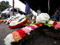 Flower wreaths are displayed for sale outside the City Mortuary, for the victims who were killed during the attack at the Westgate Shopping Centre in Nairobi