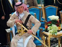 Britain's Prince Charles attends the traditional Saudi dance which was performed during Janadriya culture festival at Der'iya in Riyadh