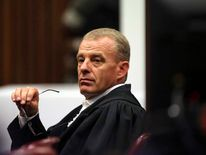 State prosecutor Gerrie Nel gestures as he cross-examines Oscar Pistorius in Pretoria