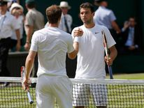 Grigor Dimitrov of Bulgaria shakes hands with Andy Murray of Britain after defeating him in their men's singles quarter-final tennis match at the Wimbledon Tennis Championships, in London