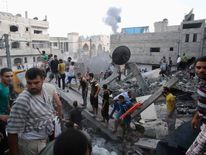 Smoke rises from buildings following what witnesses said was an Israeli air strike in Rafah