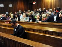 South African Olympic and Paralympic sprinter Oscar Pistorius sits in the dock before the closing arguments in the North Gauteng High Court in Pretoria
