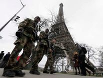 "French soldiers patrol near the Eiffel Tower in Paris as part of the ""Vigipirate"" security plan"