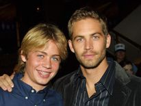 Cody Walker (left) with brother Paul in 2003.