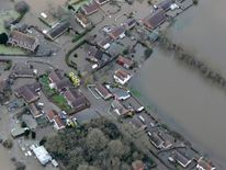 After image shows flooded properties in the village of Moorland.