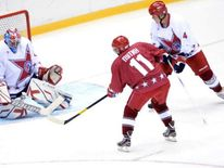 Russian president Vladimir Putin in ice hockey game at Sochi
