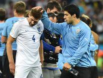 Suarez consoles Liverpool teammate Steven Gerrard after the game