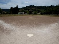 A baseball field is seen with dried grass in the outfield and a dirt infield on July 15, 2014 in Nicasio, California.