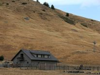 A home stands next to a hill that is brown with dead grass on July 15, 2014 in Nicasio, California.