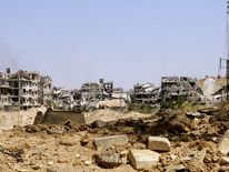 Damaged buildings in Mleiha on the outskirts of Damascus