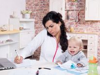 Woman with baby in home office