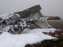 The burnt-out wreckage of a twin-engine business jet is seen on the premises of a dump near Rivenich, Germany