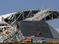 The damage caused by a crane which fell at Corinthians Arena in Sao Paulo