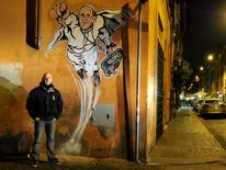 A street art mural of Pope Francis as a superman, flying through the air with his white papal cloak billowing out behind him and holding a bag bearing the word 'Values', in downtown Rome near the Vatican