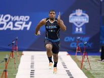 Former Missouri defensive lineman Michael Sam runs the 40-yard dash during the 2014 NFL Combine.