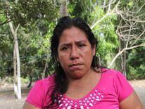 Roselia Diaz, mother of dead castaway Ezequiel Cordoba, shows his portrait during Salvadorean castaway Jose Salvador Alvarenga's visit to El Fortin, Chiapas state, Mexico