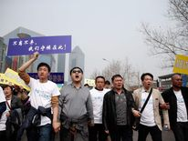 Relatives Of Missing Flight MH370 Passengers March On Malaysian Embassy In Beijing
