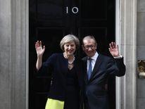 Theresa May and husband Philip wave outside 10 Downing Street