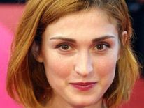French actress Julie Gayet poses upon her arrival