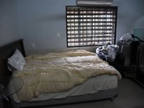 The drug lord slept on a double bed