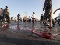 Blood is seen on the ground on the Bosphorus bridge in Istanbul after clashes  there