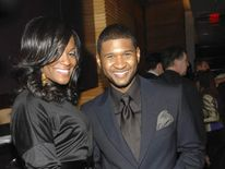 Singer Usher with ex-wife Tameka Foster
