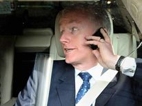 Sir Fred Goodwin, Chief-Executive Officer of the Royal Bank of Scotland, speaks on his mobile phone as he leaves the Edinburgh International Conference Centre, on April 23, 2008.