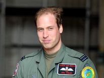 File photo dated 01/04/11 of Prince William stands in a helicopter hanger after saying goodbye to Queen Elizabeth II and the Duke of Edinburgh during a visit to RAF Valley in Anglesey.