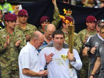 Ben Parkinson in the Olympic torch relay